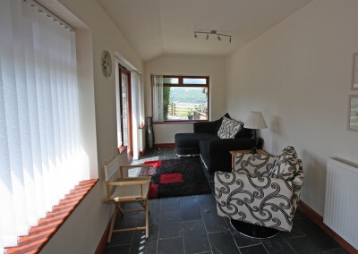 Sun room has estuary views