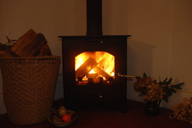 Woodburning stove and effective storage heaters keep house cosy