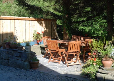 Small patio opposite house - guests welcome to enjoy view or a campfire from communal area on our adjacent small camp site