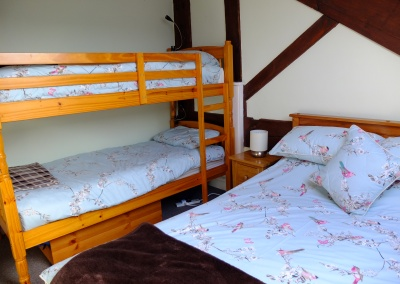 Second bedroom has double bed and bunks