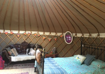 King size bed in large yurt