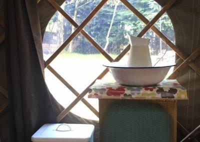 Window and simple washing facilities inside yurt