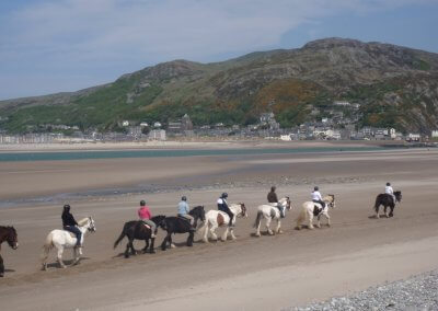 Riding on Fairbourne Beach