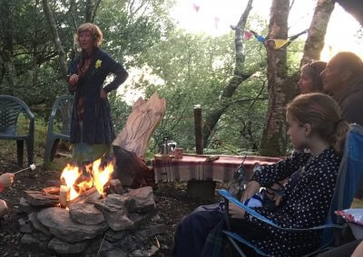 Listening to Welsh folk tales around the camp fire