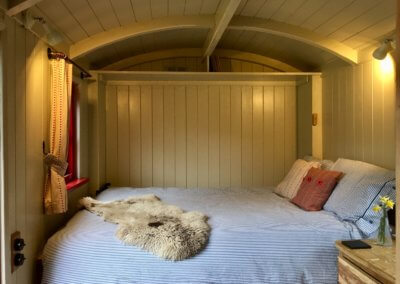 The Shepherd's Hut double bed easily pulls down from the wall at bed time