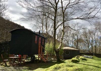 Shepherd's Hut is screened from Tommy yurt