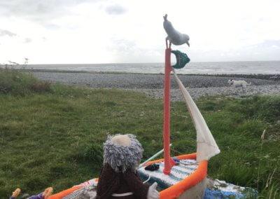 Yarn bombing on Llwyngwryil beach
