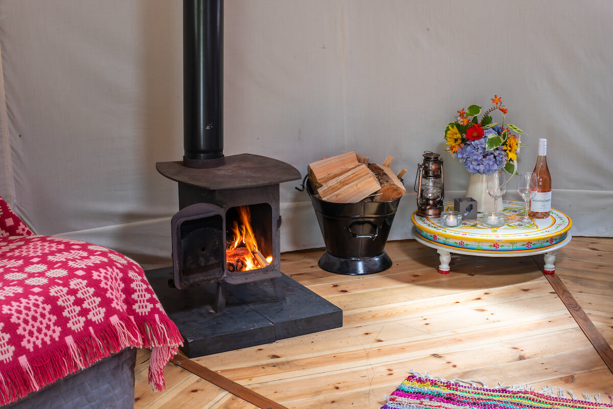 Woodburning stove with logs available on site