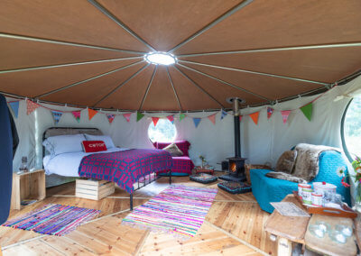 Woodburner and electric heater keeps the insulated yurt warm in winter