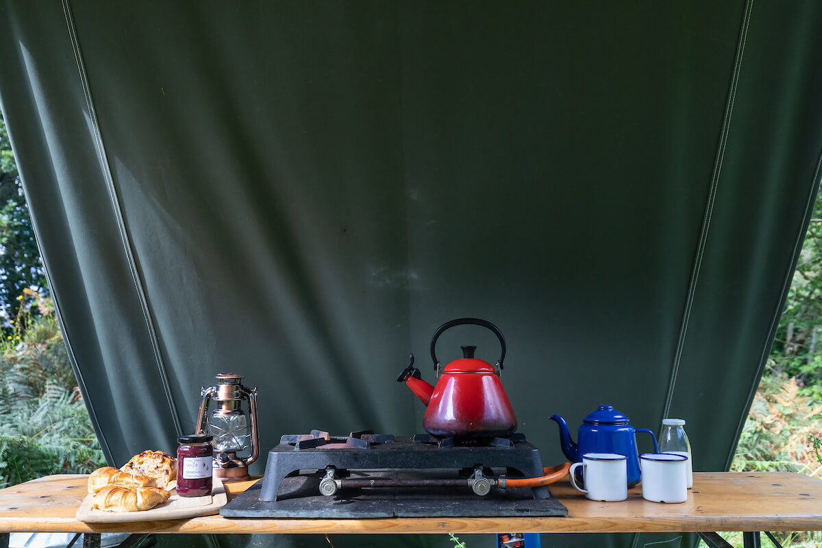 Simple cooking facilities in kitchen tent